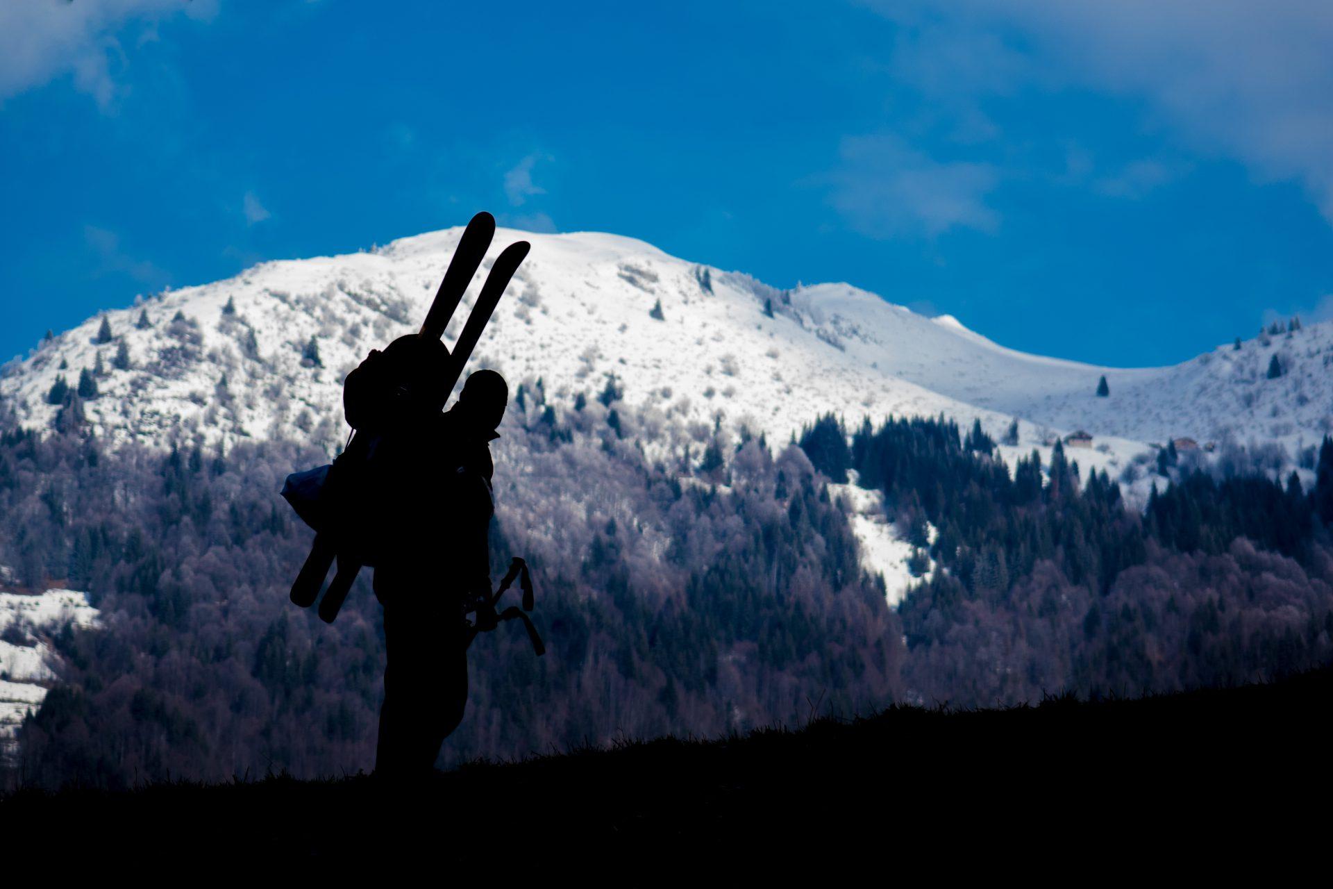 Lone skier walking up mountain